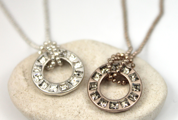 Silver and bronze crystal circle necklaces from POM